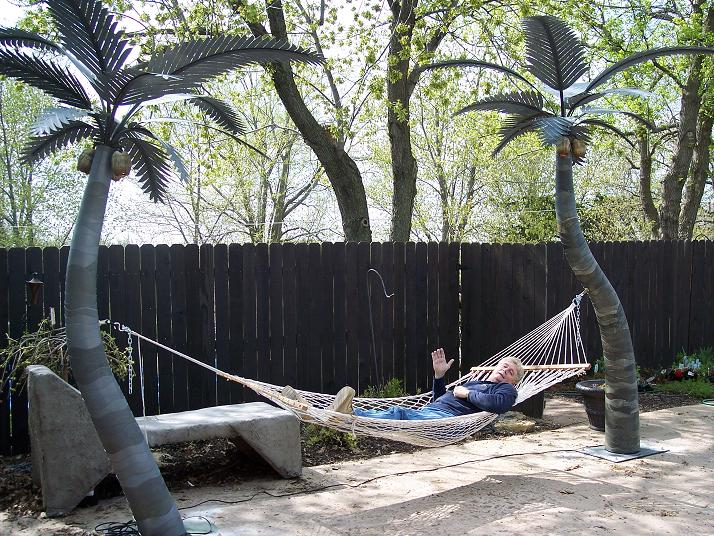 image of a fbrictaed tree holding a hammock
